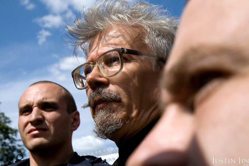Eduard Limonov at a Dissenters' rally in Moscow. Limonov, leading the march with chess champion Garry Kasparov, is a Russian nationalist writer and political dissident, and is the founder and leader of Russia's unregistered National Bolshevik Party. He was convicted in 2002, despite the protests of several State Duma members, for illegally purchasing weapons, and served about 2 years in jail..The protesters are part of a loose coalition of opposition members led by the former world chess champion Garry Kasparov and writer Eduard Limonov.