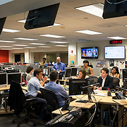 "August 29, 2014 - New York, NY : ABC News Anchor David Muir (foreground second from left -- gesturing) takes part in an editorial meeting with producers at the ""World News Tonight with David Muir"" rim  in the ABC News building on West 66th Street on Friday afternoon. David Muir is taking over for Diane Sawyer as anchor of ABC's ""World News Tonight."" CREDIT: Karsten Moran for The New York Times"