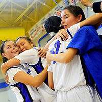 030113  Adron Gardner/Independent<br /> <br /> The Navajo Pine Lady Warriors embrace after beating the  Zuni Thunderbirds for the 1-2A district final in Navajo Friday.