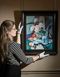 Bonham's auction house in Edinburgh will hold a sale of Scottish Art on 11th October 2017. It features works by Colourists including Samuel Peploe's 'Still life with Roses in a Chinese Vase' and Charles Lees'A Summer Evening on the Musselburgh Links which have a combined estimate of &pound;1m.<br /> <br /> Pictured: Samuel Peploe's 'Still Life with Roses in a Chinese Vase' with Bonham's member of staff, Janie Heggie