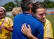 4 JUNE 2011 -- FENTON, Mo. -- St. Vincent High School soccer coach Dustin Wengert embraces player Storm French (8) after she received her individual award for the Indians' second-place finish in the MSHSAA Class 1 girls' soccer championship game at the Anheuser-Busch Center in Fenton, Mo. Saturday, June 4, 2011. St. Vincent was topped by Springfield Catholic High School 3-2. Photo © copyright 2011 Sid Hastings.
