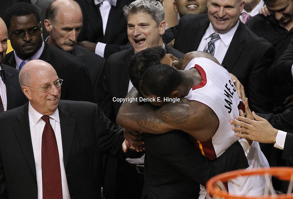 Jun 21, 2012; Miami, FL, USA; Miami Heat small forward LeBron James (6) hugs Miami Heat head coach Erik Spoelstra after winning the 2012 NBA championship at the American Airlines Arena. Miami won 121-106. Mandatory Credit: Derick E. Hingle-US PRESSWIRE