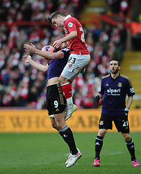 Bristol City's Joe Bryan battles for the high ball with West Ham's Andy Carroll  - Photo mandatory by-line: Joe Meredith/JMP - Mobile: 07966 386802 - 25/01/2015 - SPORT - Football - Bristol - Ashton Gate - Bristol City v West Ham United - FA Cup Fourth Round