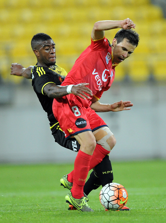 Phoenix's Rolieny Bonevacia, left and Adelaide United's Isaias contest the ball in the A-League football match at Westpac Stadium, Wellington, New Zealand, Friday, November 13, 2015. Credit:SNPA / Ross Setford