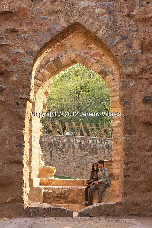 Couple share a moment in Qutb Minar in New Delhi, India.