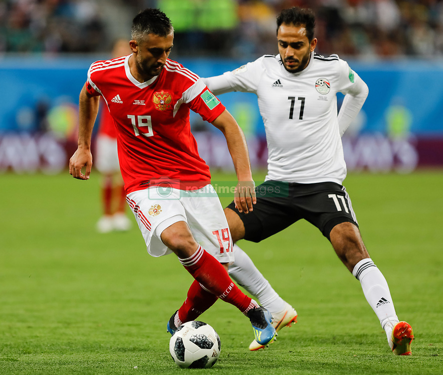 June 19, 2018 - Saint Petersburg, Russia - Alexander Samedov (L) of Russia national team and Kahraba of Egypt national team vie for the ball during the 2018 FIFA World Cup Russia group A match between Russia and Egypt on June 19, 2018 at Saint Petersburg Stadium in Saint Petersburg, Russia. (Credit Image: © Mike Kireev/NurPhoto via ZUMA Press)