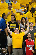 A Golden State Warriors fan celebrates a Golden State Warriors guard Stephen Curry (30) three pointer during Game 2 of the NBA Finals against the Cleveland Cavaliers at Oracle Arena in Oakland, Calif., on June 4, 2017. (Stan Olszewski/Special to S.F. Examiner)