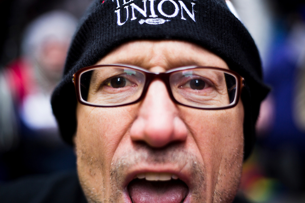 Jerry Skinner chants during a rally on March 27, 2013 protesting the closing of 54 Chicago public schools. Skinner, a English teacher at Kelvyn Park High School, participated in a sit down protest outside City Hall during the march.