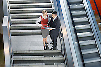 Business People Conversing on Stairway
