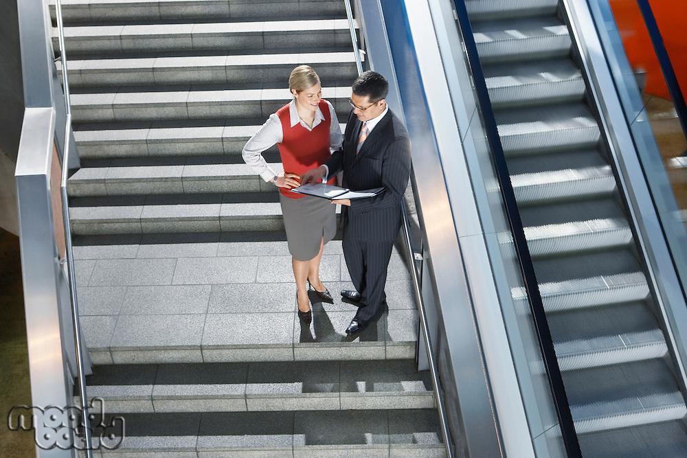 Business People Conversing on Stairway