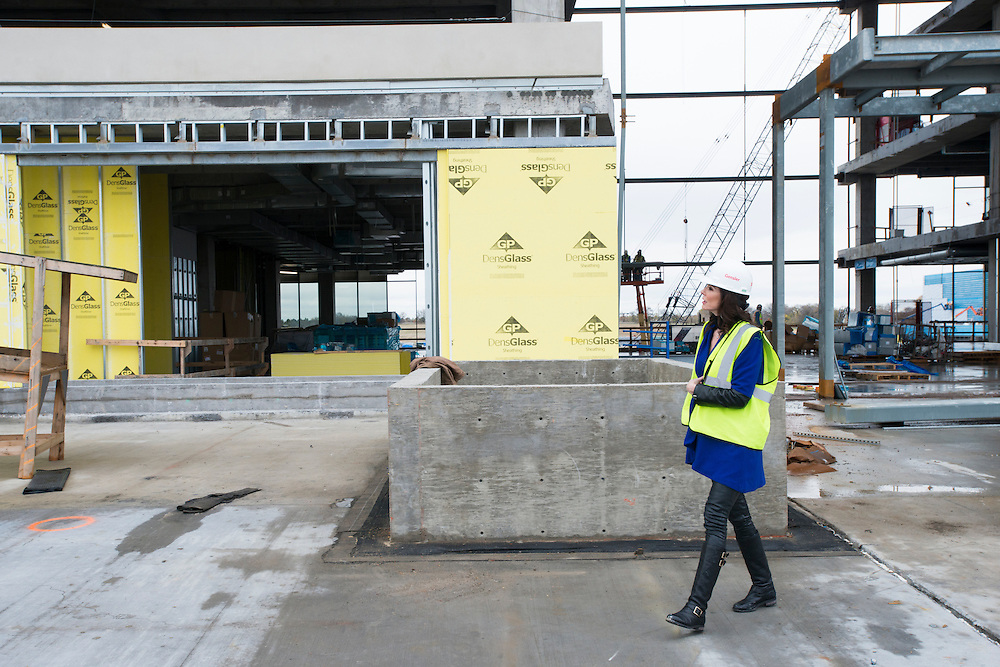 Charlotte Jones Anderson walks through the construction site at The Star, the new home of the Dallas Cowboys headquarters and practice facilities, in Frisco, Texas on November 30, 2015.  (Cooper Neill for The New York Times)