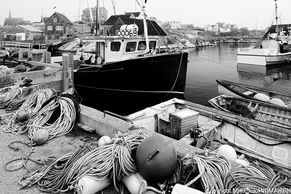 Fishing boats and gear in village<br />