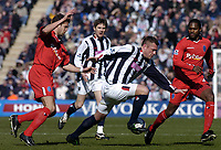 Fotball<br /> Premier League 2004/05<br /> West Bromwich v Birmingham<br /> 6. mars 2005<br /> Foto: Digitalsport<br /> NORWAY ONLY<br /> West Brom's Geoff Horsfield (C) is brought down by Matthew Upson (L)
