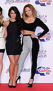 09.DECEMBER.2012. LONDON<br /> <br /> CHERYL COLE AND KIMBERLEY WALSH AT DAY 2 OF CAPITAL FM'S JINGLE BELL BALL AT THE 02 ARENA IN GREENWICH.<br /> <br /> BYLINE: EDBIMAGEARCHIVE.CO.UK<br /> <br /> *THIS IMAGE IS STRICTLY FOR UK NEWSPAPERS AND MAGAZINES ONLY*<br /> *FOR WORLD WIDE SALES AND WEB USE PLEASE CONTACT EDBIMAGEARCHIVE - 0208 954 5968*