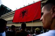"Vetvendosje (""Self-Determination"" in Albanian) protest. Large Albanian flag (symbol of Kosovar nationalism) unfurled in downtown Pristina...Pristina, Kosovo, Serbia."