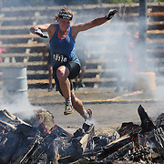 Britton Soderberg in action at the fire jump obstacle during the Reebok Spartan Race. Mohegan Sun, Uncasville, Connecticut, USA. 28th June 2014. Photo Tim Clayton