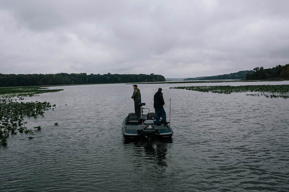 Seth Winslow, left, and Travis Riley, right, of Christopher Newport University, fish for bass during the FLW College Fishing Northern Conference Invitational in Marbury, MD on Oct. 11, 2014. Only the top 15 of 43 teams moved on to Sunday.