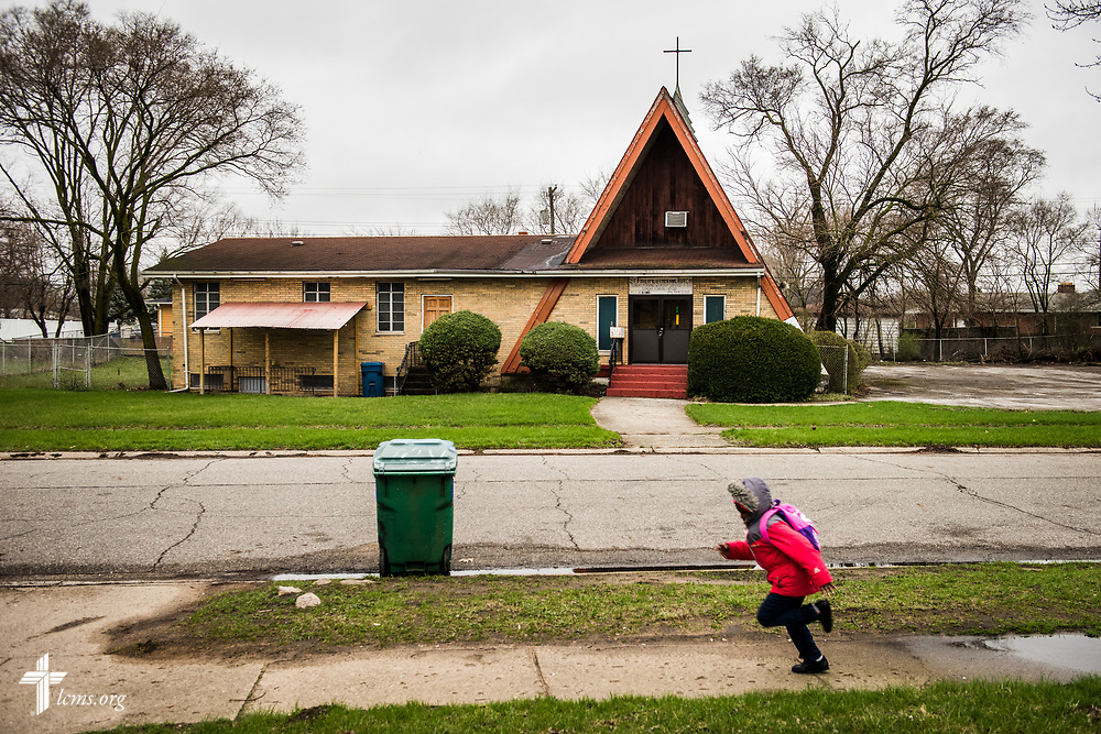 A young girl runs on the sidewalk across the street from St. Philip Lutheran Church on Wednesday, April 5, 2017, in a neighborhood of Gary, Ind. LCMS Communications/Erik M. Lunsford