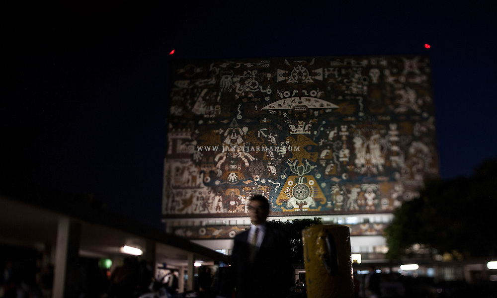 Students attend night classes, passing by the iconic library at the Central University City Campus of the Universidad Nacional Autónoma de México (UNAM). The campus, a UNESCO World Heritage Site, is an important example of 20th century modernism.