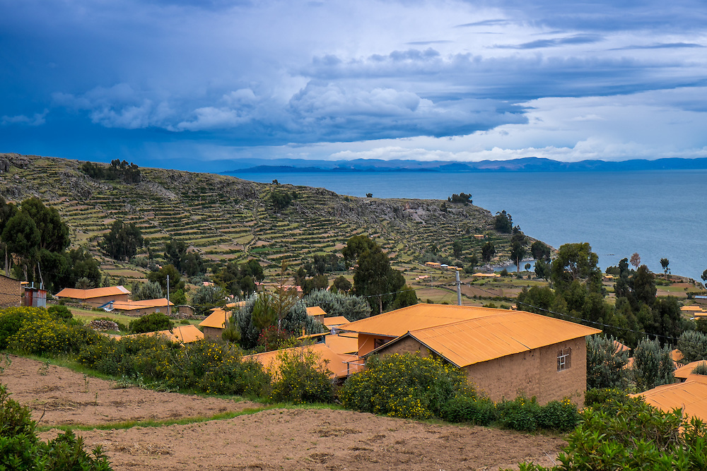 View of houses and terraces in Amantani Island in Lake Titicaca, Peru.