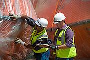 GAC Employees inspecting life raft