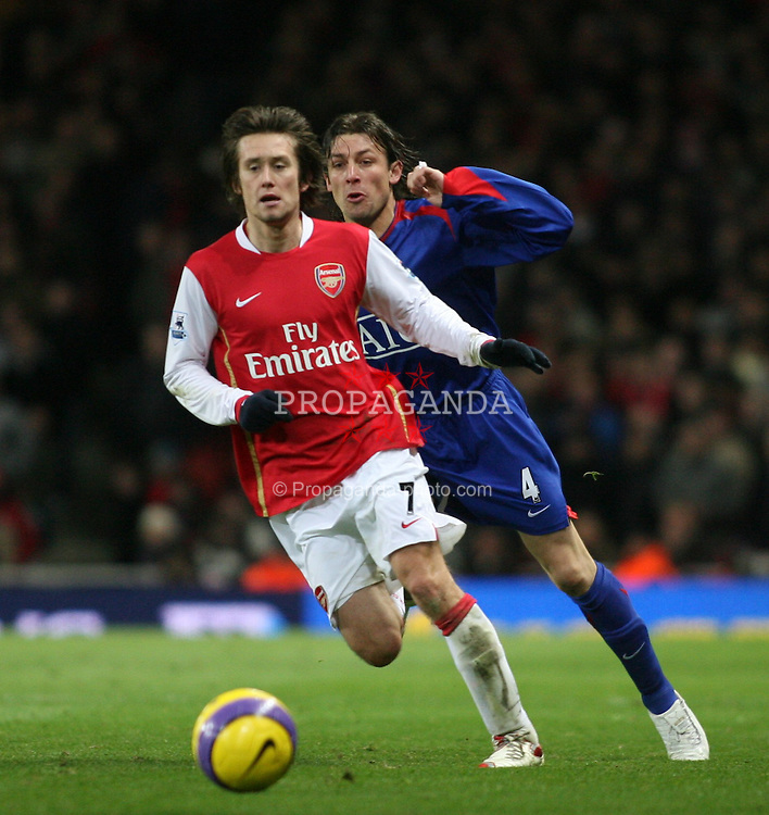 London, England - Sunday, January 21, 2007: Arsenal's Tomas Rosicky and Manchester United's Gabriel Heinze during the Premier League match at the Emirates Stadium. (Pic by Chris Ratcliffe/Propaganda)