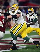 Green Bay Packers tackle Bryan Bulaga (75) blocks during the NFL NFC Divisional round playoff football game against the Arizona Cardinals on Saturday, Jan. 16, 2016 in Glendale, Ariz. The Cardinals won the game in overtime 26-20. (©Paul Anthony Spinelli)