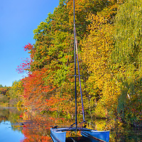 Massachusetts sailboat photography from Wellesley College at Lake Waban in Wellesley Massachusetts showing a catamaran framed by beautiful fall foliage. This Massachusetts lake with Wellesley College nearby are inspiring and make for a beautiful New England nature photography location to visit and to get lost with a camera.<br /> <br /> Lake Waban Massachusetts photos are available as museum quality photo, canvas, acrylic, wood or metal prints. Wall art prints may be framed and matted to the individual liking and wall art décor project needs:<br /> <br /> https://juergen-roth.pixels.com/featured/lake-waban-catamaran-juergen-roth.html<br /> <br /> Good light and happy photo making!<br /> <br /> My best,<br /> <br /> Juergen<br /> Photo Prints & Licensing: http://www.rothgalleries.com<br /> Photo Blog: http://whereintheworldisjuergen.blogspot.com<br /> Instagram: https://www.instagram.com/rothgalleries<br /> Twitter: https://twitter.com/naturefineart<br /> Facebook: https://www.facebook.com