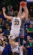SOUTH BEND, IN - JANUARY 12: John Mooney #33 of the Notre Dame Fighting Irish shoots the ball against Nik Popovic #21 of the Boston College Eagles at Purcell Pavilion on January 12, 2019 in South Bend, Indiana. (Photo by Michael Hickey/Getty Images) *** Local Caption *** John Mooney; Nik Popovic