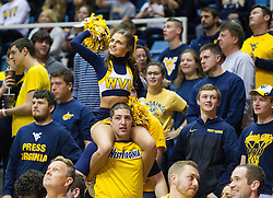 Nov 20, 2016; Morgantown, WV, USA; A West Virginia Mountaineers cheerleader cheers during the second half against the New Hampshire Wildcats at WVU Coliseum. Mandatory Credit: Ben Queen-USA TODAY Sports