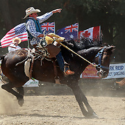 Ed Hordern, Australia, in action during the Open Saddle Bronc competition at the Millers Flat Rodeo. Otago, New Zealand. 26th December 2011