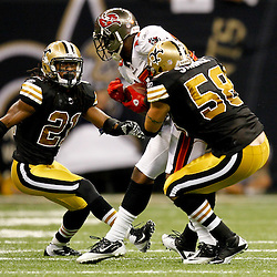 November 6, 2011; New Orleans, LA, USA; New Orleans Saints cornerback Patrick Robinson (21) and linebacker Scott Shanle (58) tackle Tampa Bay Buccaneers wide receiver Arrelious Benn (17) during the second quarter of a game at the Mercedes-Benz Superdome. Mandatory Credit: Derick E. Hingle-US PRESSWIRE