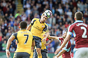 Arsenal defender Nacho Monreal (18) heads clear of goal during the Premier League match between Burnley and Arsenal at Turf Moor, Burnley, England on 2 October 2016. Photo by Pete Burns.