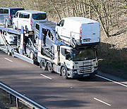 Ford Scania vehicle transporter on A12 road, Suffolk, England