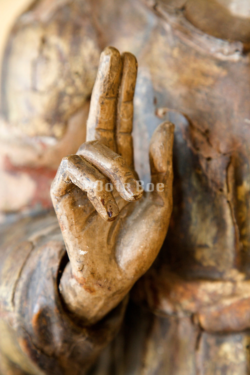 close up of the hand of a blessing Jesus statue