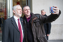 © Licensed to London News Pictures. 13/11/2016. London, UK. Leader of the Labour Party Jeremy Corbyn MP stops for a selfie as he arrives at the Andrew Marr Show today. The show has been heavily criticised for screening a pre-recorded interview with far-right politician Marine Le Pen, who associates with Le Front National (The National Front). Photo credit : Tom Nicholson/LNP