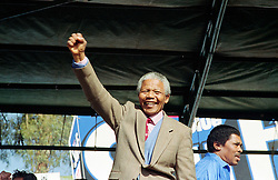 NELSON ROLIHLAHLA MANDELA (July 18, 1918 - December 5, 2013), 95, world renown civil rights activist and world leader. Mandela emerged from prison to become the first black President of South Africa in 1994. As a symbol of peacemaking, he won the 1993 Nobel Peace Prize. Joined his countries anti-apartheid movement in his 20s and then the ANC (African National Congress) in 1942. For next 20 years, he directed a campaign of peaceful, non-violent defiance against the South African government and its racist policies and for his efforts was incarcerated for 27 years. Remained strong and faithful to his cause, thru out his life, of a world of peace. Transforming the world, to make it a better place. PICTURED: 1992 - South Africa - NELSON MANDELA at a rally. (Credit Image: © Greg Marinovich/ZUMA Wire/ZUMAPRESS.com)