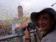 Italian photojournalist Alberto Buzzola watches as confetti is launched as part of the Republic of China (Taiwan) National Day celebration on October 10, in front of the Presidential Palace in Taipei.<br />