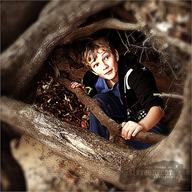 Gary Cosby Jr.  iPhone photographs  A child imitates Frodo Baggins hiding beneath tree roots.