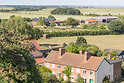 North Sea village landscape over fields in summer at Bawdsey, Suffolk, England, UK view from church tower