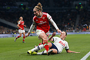 Anna Filbey tackles Kim Little during the FA Women's Super League match between Tottenham Hotspur Women and Arsenal Women FC at Tottenham Hotspur Stadium, London, United Kingdom on 17 November 2019.