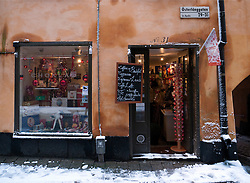 Small chocolate shop in Gamla Stan old town district in winter in Stockholm Sweden