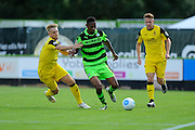 Ethan Pinnock (16) of Forset Green Rovers battles for possession with Callum Howe of Southport during the Vanarama National League match between Forest Green Rovers and Southport at the New Lawn, Forest Green, United Kingdom on 29 August 2016. Photo by Graham Hunt.
