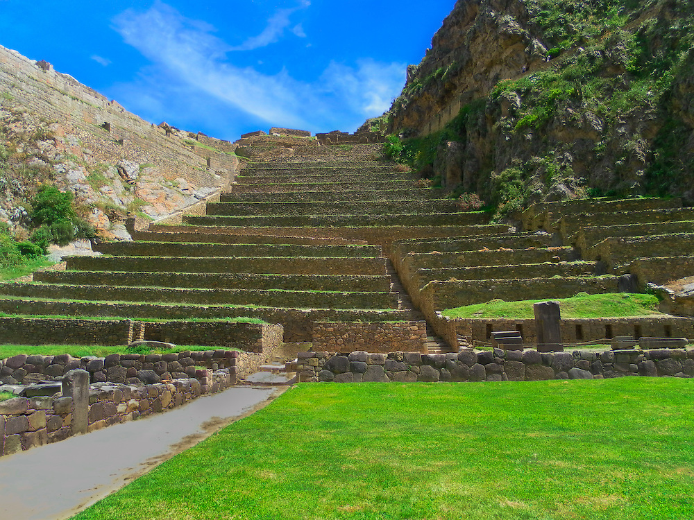 Ollantaytambo is a village in the Sacred Valley of south Peru, set on the Urubamba River amid snow-capped mountains. It's known for the Ollantaytambo ruins, a massive Inca fortress with large stone terraces on a hillside. Major sites within the complex include the huge Sun Temple and the Princess Baths fountain. The village's old town is an Inca-era grid of cobblestoned streets and adobe buildings.