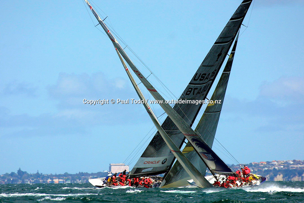 Louis Vuitton Cup 2002 - Round Robin 1: 01-14 October 2002<br /> Oracle BMW Racing crosses ahead of Mascalzone Latino on the Hauraki Gulf<br />Please Credit: Paul Todd/ Photosport