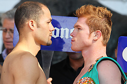 "November 26, 2011; Mexico City, Mexico; Saul ""Canelo"" Alvarez (right) and Kermit Cintron (left) pose after the weigh-in for their 12 round bout at the Plaza de Toros Bullring in Mexico City."