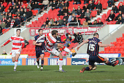 Blackpool defender Tom Aldred (15)  blocks Doncaster Rovers forward Andy Williams (11) shot during the Sky Bet League 1 match between Doncaster Rovers and Blackpool at the Keepmoat Stadium, Doncaster, England on 28 March 2016. Photo by Simon Davies.