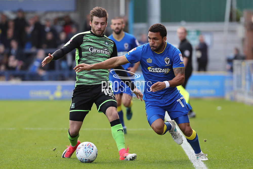 AFC Wimbledon striker Andy Barcham (17) battles for possession with Plymouth Argyle midfielder Graham Carey (10) during the EFL Sky Bet League 1 match between AFC Wimbledon and Plymouth Argyle at the Cherry Red Records Stadium, Kingston, England on 21 October 2017. Photo by Matthew Redman.