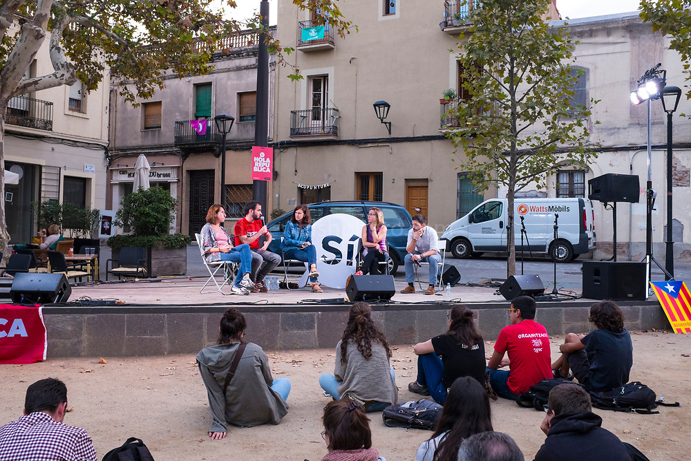 Members of pro-independence organisations speak in Placa Barcelona, Sant Cugat, Barcelona, Catalonia September 21st 2017. The Spanish government is opposed to holding the October 1st Referendum on independence. On September 20th, Spanish authorities carried out raids on companies, government offices and political parties, arresting politicians and activists and the confiscation of  referendum materials belonging to the Catalan independence movement. Ordinary people have started printing and distributing posters and have taken to the streets in response.