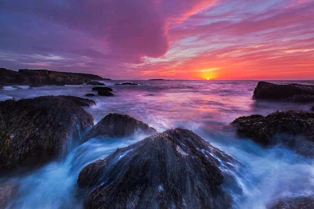 Exceptional lycolorful and dramatic sunrise light along the rocky coast of Acadia National Park in Maine.  Incoming waves timed to create foreground interest and leading lines. (3 stop reverse grad ND)